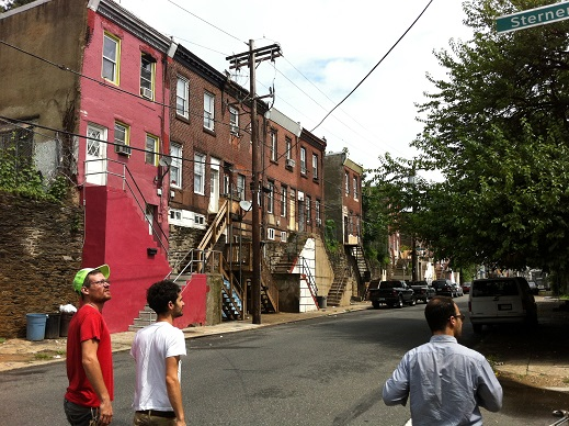 Artists Billy Dufala and Jacob Hellman survey a North Philadelphia neighborhood with public historian Patrick Grossi.