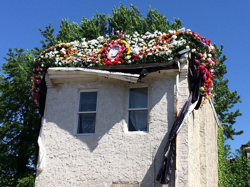3711 Melon Street, adorned with a crown of garlands.